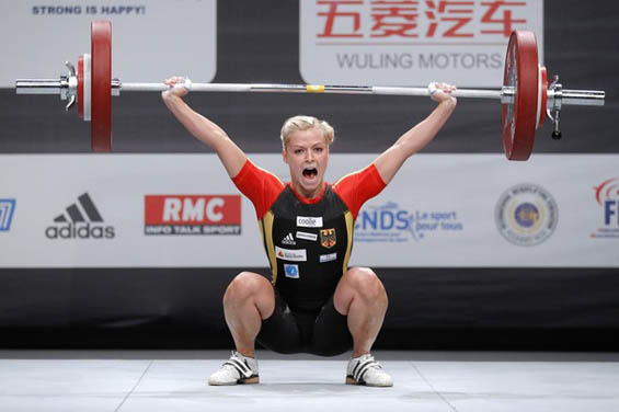 Julia Rohde of Germany competes in the women's 53kg weightlifting competition during the World Weightlifting Championships in Marne-la-Vallee outside Paris